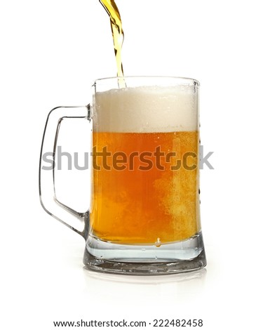 pouring beer in mug isolated on white