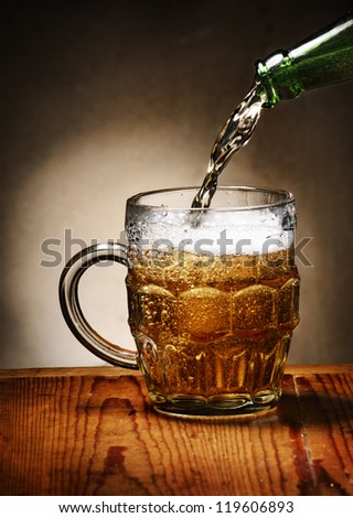 Pouring beer into beer mug