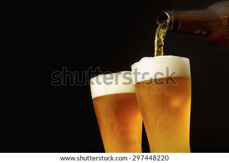 Pouring beer into glass - stock photo