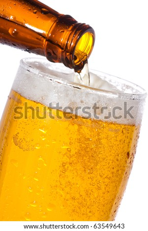 Pouring Beer into glass on white background - stock photo
