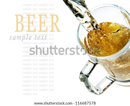 Pouring beer into mug isolated on white background - stock photo