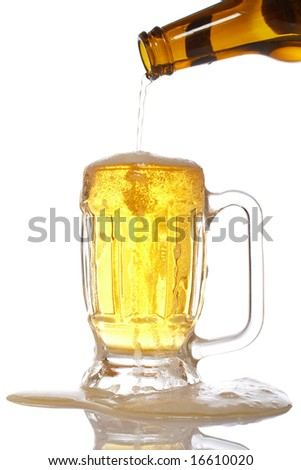 Pouring beer into mug reflected over white background