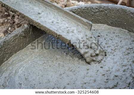 Pouring cement during for construction - stock photo