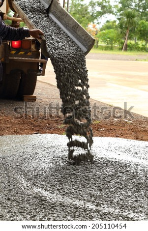 Pouring cement during sidewalk upgrade - stock photo