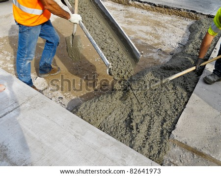 Pouring cement during Upgrade to residential street
