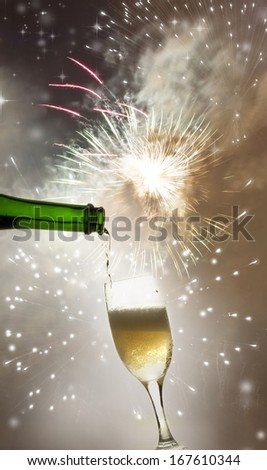 Pouring champagne against fireworks and holiday lights  - stock photo