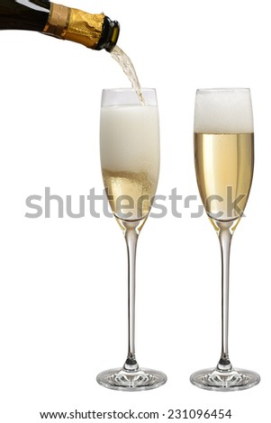 Pouring champagne in glasses - stock photo
