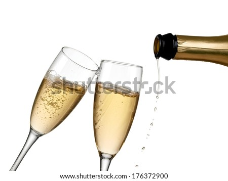 Pouring champagne into two glasses. - stock photo