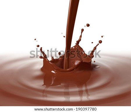 pouring chocolate drink causing splash and ripple - stock photo