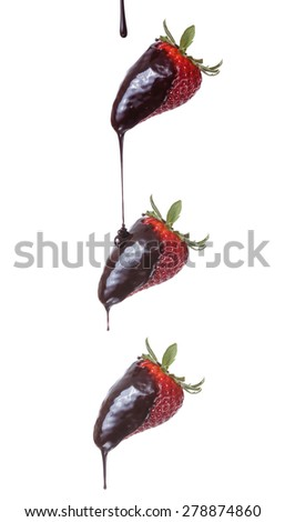 Pouring chocolate on strawberries isolated on white background