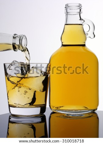 POURING CIDER - stock photo