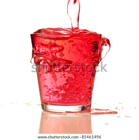 pouring cocktail on a glass on a white background