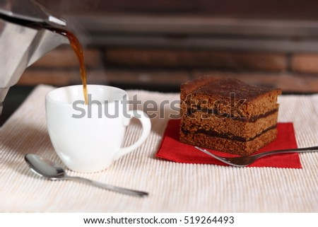 Pouring Coffee into Cup and Gingerbread Layer Cake with Jam