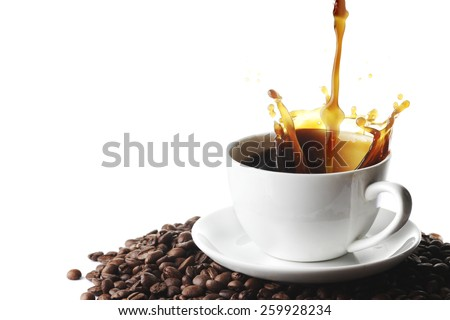 Pouring coffee with splash in cup on coffee beans isolated on white background - stock photo