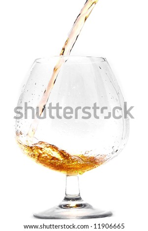 Pouring cognac into a Glass. - stock photo