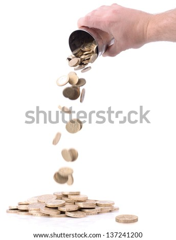 pouring coins out of a tin can isolated on white - stock photo