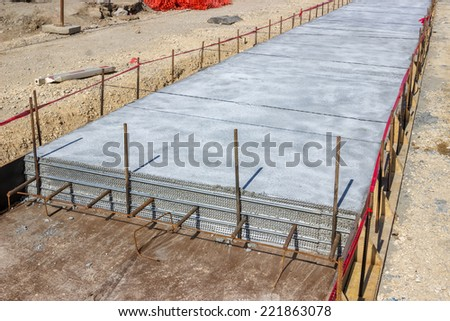 Pouring concrete supports for the tram tracks, concrete bed for tracklaying. Selective focus. - stock photo
