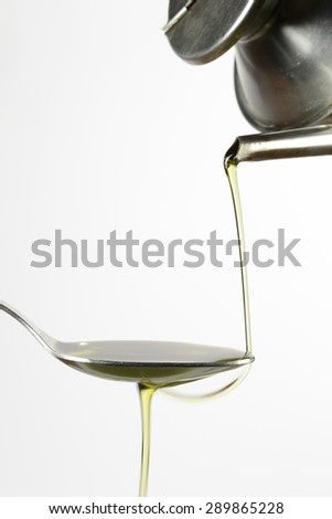 Pouring extra-virgin olive oil from a typical cruet