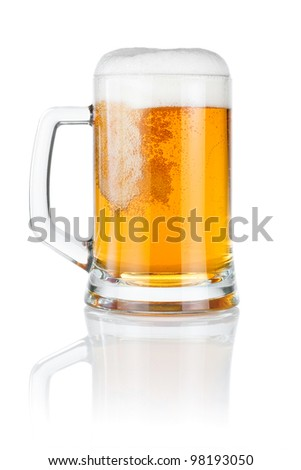 Pouring fresh beer into mug isolated over a white background - stock photo