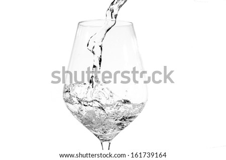 Pouring fresh water into a glass isolated on white background - stock photo
