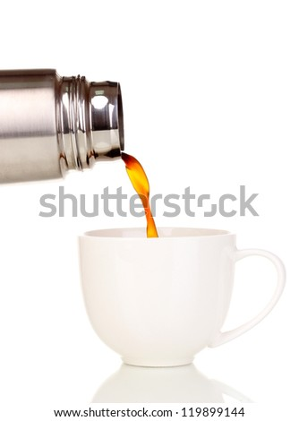 pouring from thermos into cup isolated on white - stock photo
