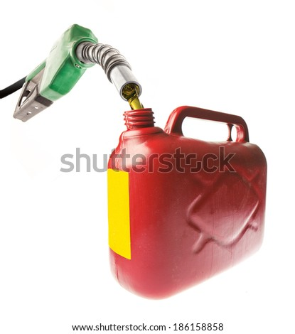 Pouring gasoline in a red jerrycan with a green nozzle on white - stock photo