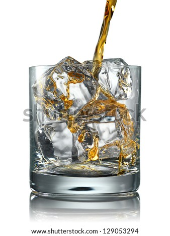 Pouring Glass of scotch whiskey and ice on a white background - stock photo