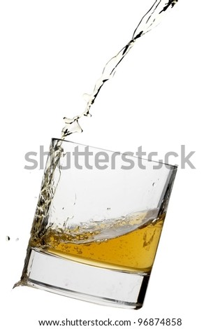 Pouring glass of Whiskey - stock photo
