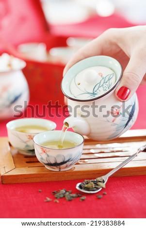 Pouring green tea - stock photo