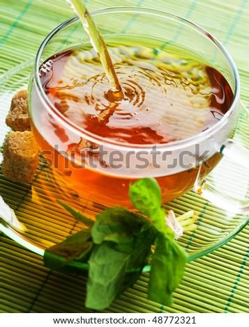 Pouring healthy Tea - stock photo