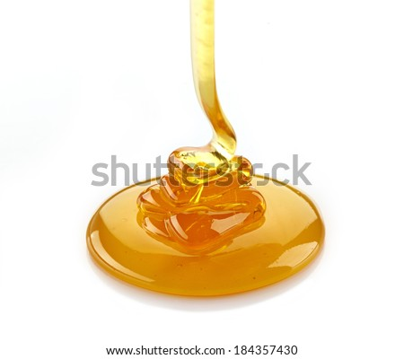 pouring honey isolated on a white background - stock photo