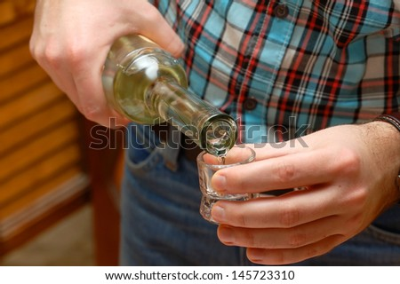 Pouring hungarian fruit brandy - stock photo