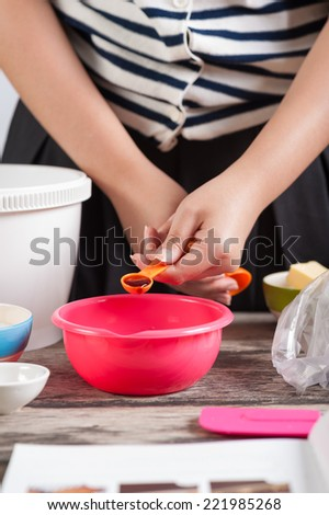 Pouring ingredient into a cup