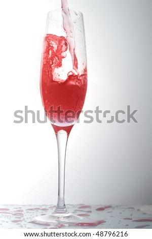 pouring liquid into  wineglass
