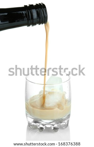 Pouring liquor in glass isolated on white
