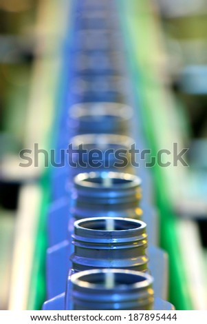 pouring lubricants in typical containers - stock photo