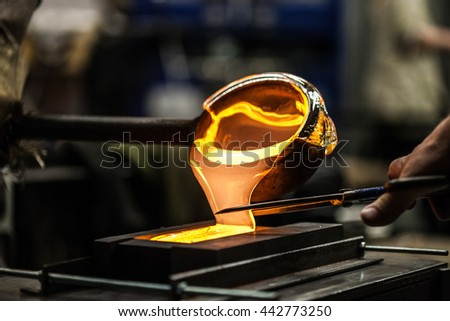 Pouring Melted Glass into Graphite Mold in Workshop