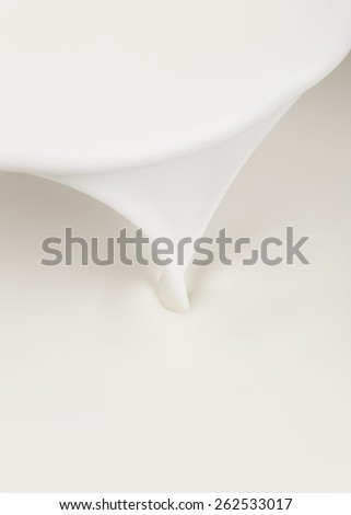 Pouring milk, abstract background