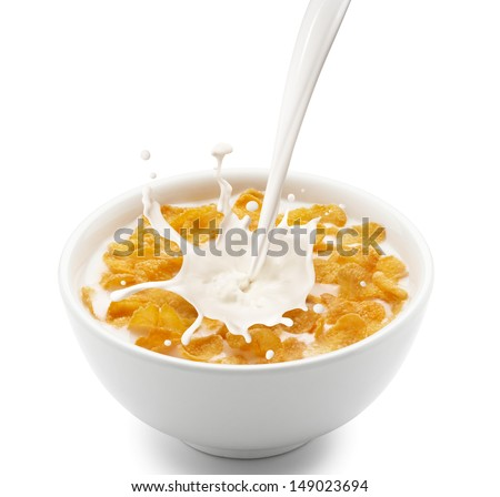 pouring milk into corn flakes creating splash - stock photo