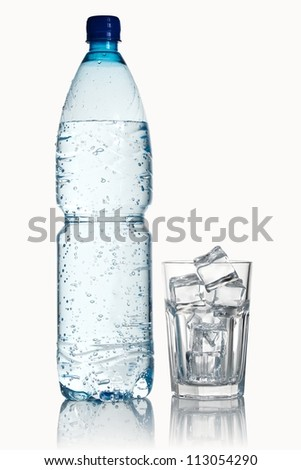 Pouring mineral water in a water glass, isolated on white - stock photo