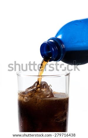 Pouring of cola in the glass with ice,Selective focus on glass - stock photo