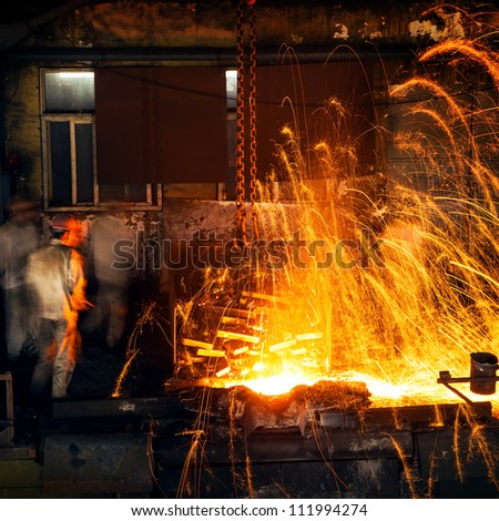 Pouring of liquid metal in open hearth workshop - stock photo