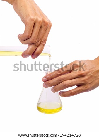pouring oil into a test tube glass  - stock photo