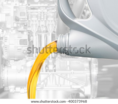 Pouring oil lubricant motor car from bottle on engine background - stock photo