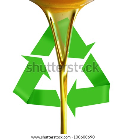 Pouring oil or golden liquid on recycle symbol - stock photo