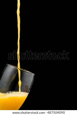 Pouring orange juice into glass. Copy space.