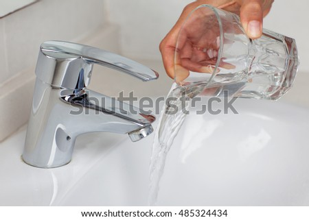 Pouring out water in the tap