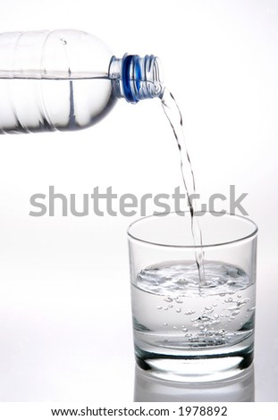 pouring plain water into a glass