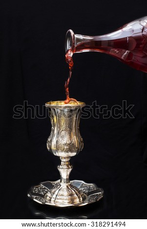 Pouring red wine into a glass Silver
