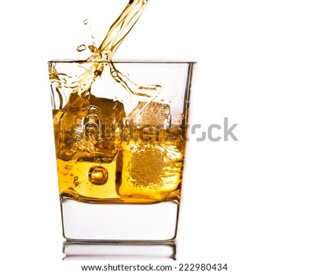 pouring scotch whiskey in glass with ice cubes isolated on white background - stock photo